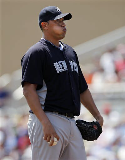 New York Yankees starting pitcher Freddy Garcia (36) puffs out his cheeks after giving up a second-inning, solo home run to Toronto Blue Jays designated hitter Edwin Encarnacion during their spring training baseball game in Dunedin, Fla., Wednesday, March 14, 2012. Garcia had further troubles in the game. He left the game after he was hit in the right hand by Edwin Encarnacion's fourth-inning, one-hopper to the mound. (AP Photo/Kathy Willens)