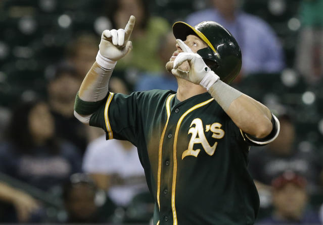 Oakland Athletics' Josh Donaldson looks skyward after as he crosses the plate on a two-run homer against the Houston Astros in the ninth inning of a baseball game Friday, April 25, 2014, in Houston. (AP Photo/Pat Sullivan)