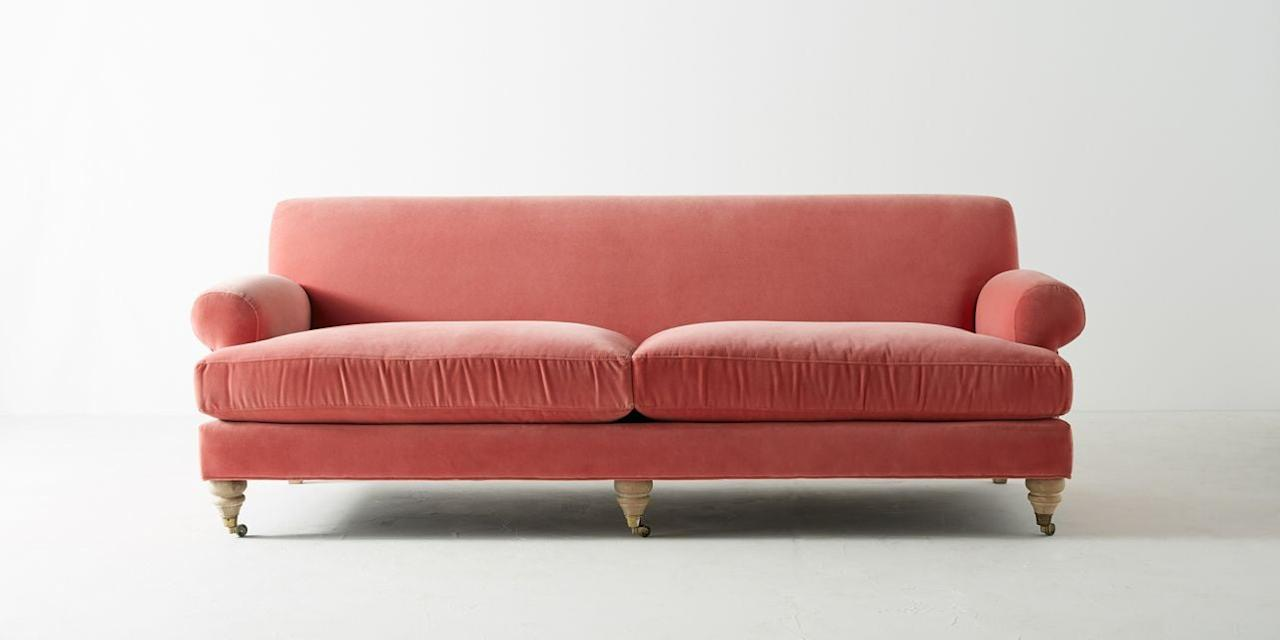 """<p>Lorelai would love curling up for a movie night on this bright, coral-colored <a href=""""https://www.popsugar.com/buy/Willoughby-Two-Cushion-Sofa-497674?p_name=Willoughby%20Two-Cushion%20Sofa&retailer=anthropologie.com&pid=497674&price=1%2C598&evar1=casa%3Aus&evar9=46711719&evar98=https%3A%2F%2Fwww.popsugar.com%2Fhome%2Fphoto-gallery%2F46711719%2Fimage%2F46712541%2FGet-Look-Willoughby-Two-Cushion-Sofa&list1=home%20decor%2Chome%20shopping&prop13=api&pdata=1"""" rel=""""nofollow"""" data-shoppable-link=""""1"""" target=""""_blank"""" class=""""ga-track"""" data-ga-category=""""Related"""" data-ga-label=""""http://www.anthropologie.com/shop/willoughby-two-cushion-sofa"""" data-ga-action=""""In-Line Links"""">Willoughby Two-Cushion Sofa</a> ($1,598), with its bright colors and simple design.</p>"""