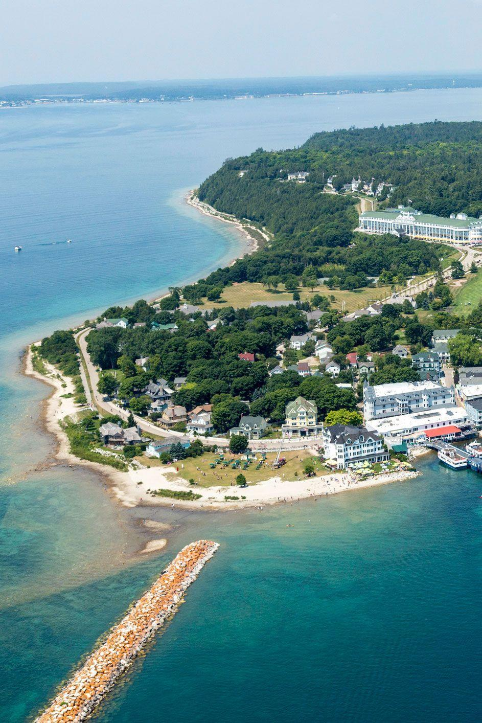"""<p><strong>Where: </strong>Mackinac Island, Michigan</p><p><strong>Why We Love It: </strong>No cars are allowed on <a href=""""https://www.countryliving.com/life/travel/g4135/american-islands/"""" rel=""""nofollow noopener"""" target=""""_blank"""" data-ylk=""""slk:this small island"""" class=""""link rapid-noclick-resp"""">this small island</a> on the strait between Michigan's upper and lower peninsulas, making it an idyllic summer getaway.</p>"""