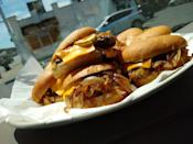 <p>Serving some of America's best sliders since 1929, this humble Detroit mainstay is a must-visit for any burger lover passing through the city. When you're in town, grab one of the famous sliders with cheese — a masterpiece with grilled onions, pickles, ketchup and mustard.</p>
