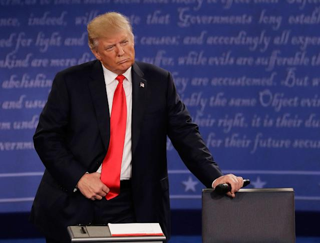 <p>Republican presidential nominee Donald Trump listens to Democratic presidential nominee Hillary Clinton during the second presidential debate at Washington University in St. Louis, Mo., Sunday, Oct. 9, 2016. (Photo: Patrick Semansky/AP) </p>