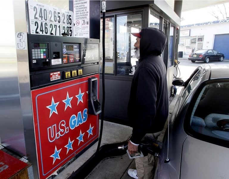 A gas station attendant fills a customer's vehicle in Turnersville, New Jersey