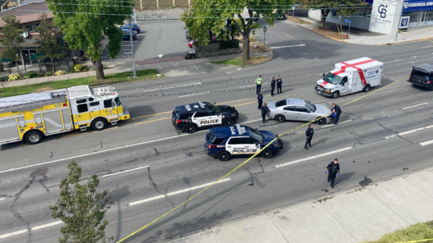 Emergency responders at Douglas Street and Tolmie Avenue in Victoria, where a man was shot and killed by police on Sept. 12. (CHEK News - image credit)