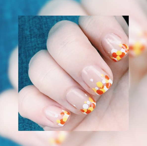 """<p><a rel=""""nofollow"""" href=""""https://www.instagram.com/p/BLha2cWlGdQ/?taken-by=isthatphi&hl=en"""">@ISTHATPHI</a> — Candy corn inspired and supercute, you will have everyone drooling over your delicious mani. </p>"""