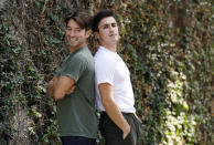 TikTok personalities Ian Paget, left, and Chris Olsen pose for a portrait in West Hollywood, Calif. on Oct. 20, 2020. Paget and Olsen, gay partners in Los Angeles, have amassed more than 4 million followers who love and encourage them as they hunker down at home, churning out goofy dance videos and playing the constant pranks that are stock-in-trade on TikTok. (AP Photo/Chris Pizzello)