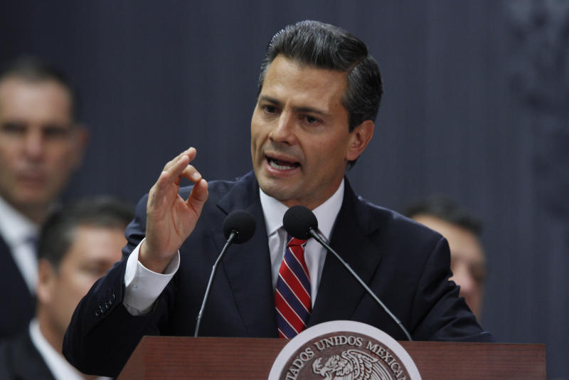 Mexico's President Enrique Pena Nieto speaks at Los Pinos presidential residence in Mexico City, Sunday Sept. 8, 2013. Pena Nieto is proposing a plan to implement the country's first nationwide pensions, unemployment insurance and capital-gains taxes. The plan was originally billed as a reform of the tax system to close industry-specific loopholes, but Pena Nieto also proposed a carbon tax, and a levy on soft drinks.(AP Photo/Marco Ugarte)
