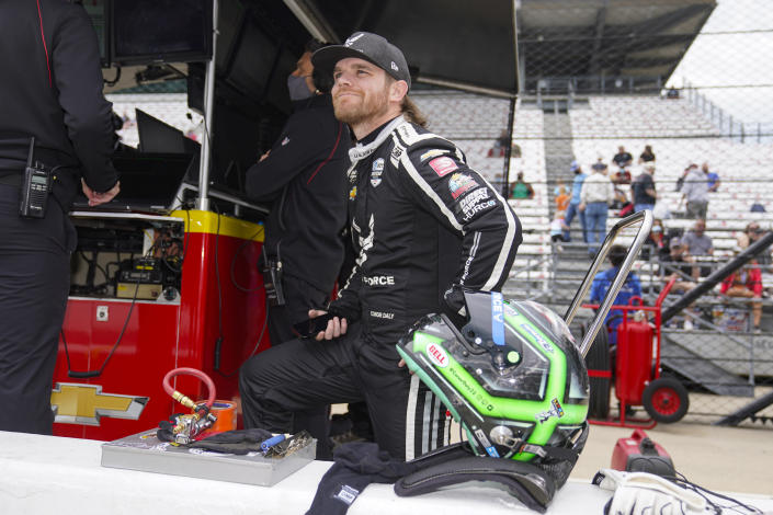 Conor Daly waits for the start of practice for the Indianapolis 500 auto race at Indianapolis Motor Speedway in Indianapolis, Tuesday, May 18, 2021. (AP Photo/Michael Conroy)