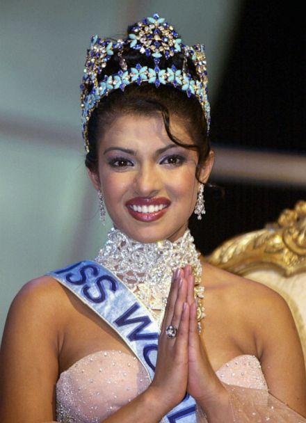 PHOTO: Miss India Priyanka Chopra, smiles as she sits with the Miss World crown after winning the title at London's Millennium Dome in this Nov. 30, 2000 file photo. (Adam Butler/AP, FILE)
