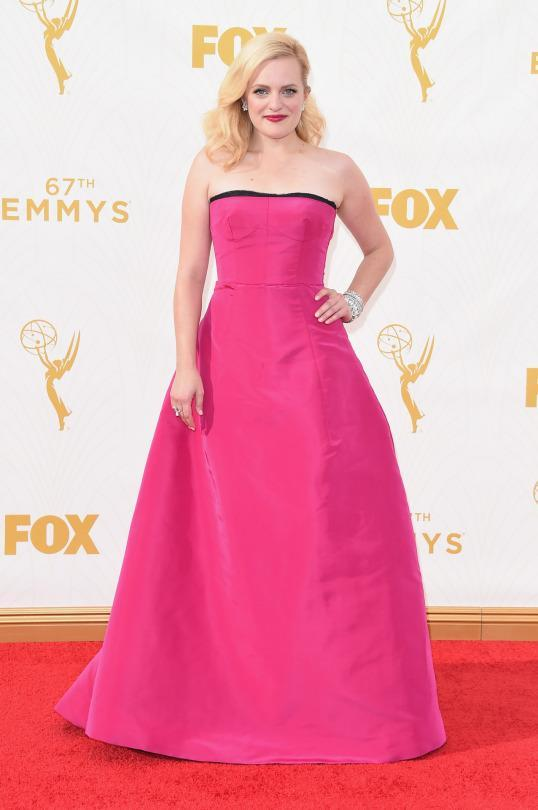 <p>Elizabeth Moss wore a Peter Copping for Oscar de la Renta hot pink gown. While she wasn't the best dressed in magenta, the silhouette was still nice on her and the platinum blonde hair worked great with the bright shade. </p>