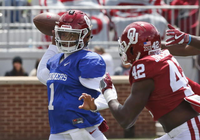 Oklahoma quarterback Kyler Murray (1) passes under pressure from Mark Jackson, Jr. (42) during the Oklahoma NCAA college football spring intrasquad game in Norman, Okla., Saturday, April 14, 2018. (AP Photo/Sue Ogrocki)