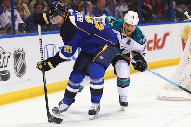 ST. LOUIS, MO - APRIL 21: Patrik Berglund #21 of the St. Louis Blues controls the puck against Ryane Clowe #29 of the San Jose Sharks during Game Five of the Western Conference Quarterfinals during the 2012 NHL Stanley Cup Playoffs at the Scottrade Center on April 21, 2012 in St. Louis, Missouri. The Blues beat the Sharks 3-1 to advance to the Western Conference Semifinals. (Photo by Dilip Vishwanat/Getty Images)