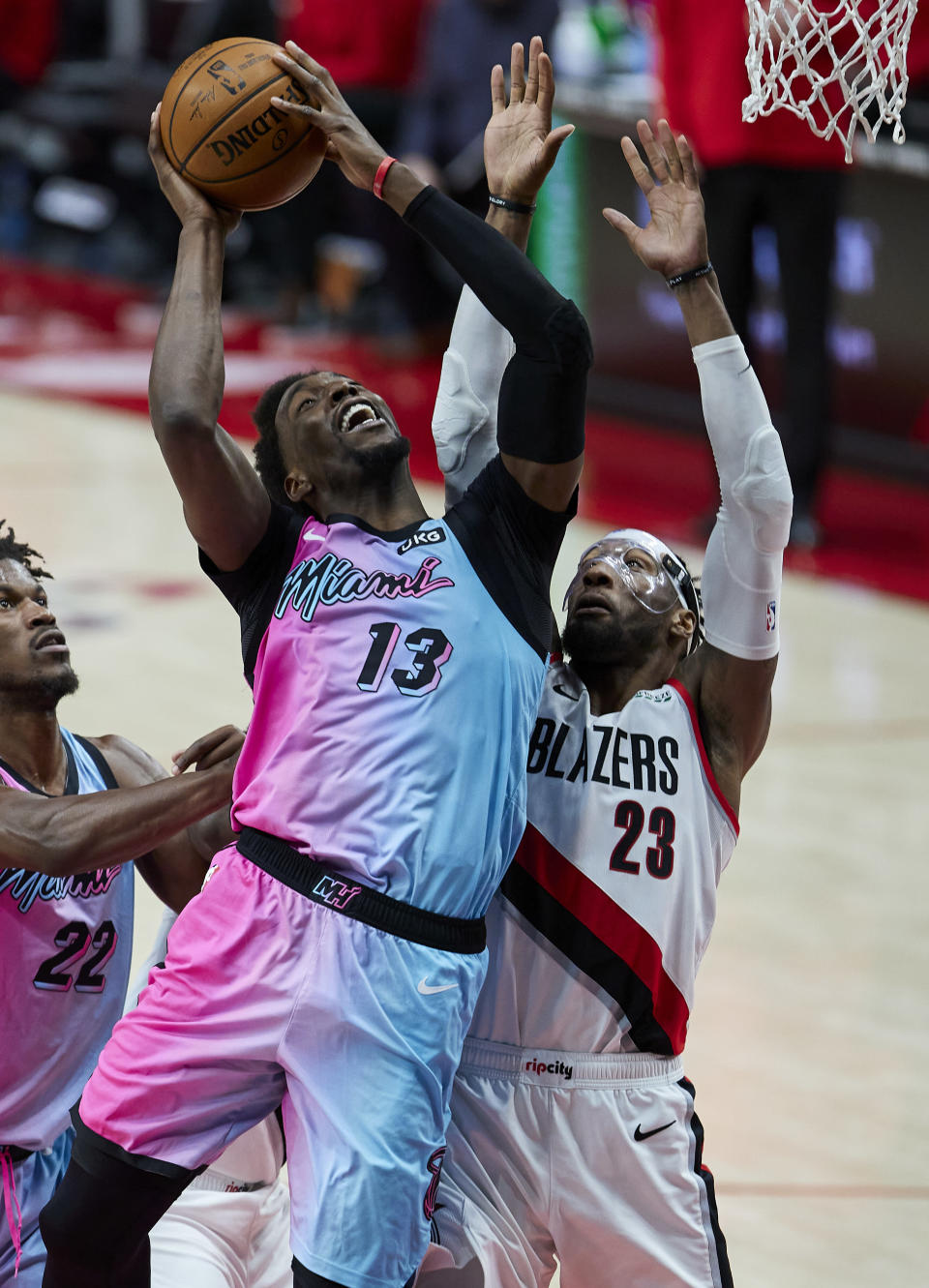 Miami Heat center Bam Adebayo, left, shoots over Portland Trail Blazers forward Robert Covington during the first half of an NBA basketball game in Portland, Ore., Sunday, April 11, 2021. (AP Photo/Craig Mitchelldyer)