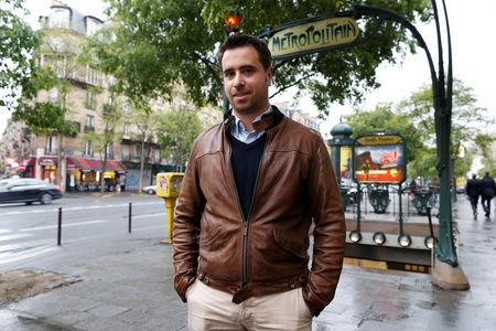 Aymeric Durox, a teacher and supporter of Marine Le Pen, French National Front (FN) candidate for 2017 presidential election, poses in front of a metro station in Paris, France, May 3, 2017. REUTERS/Charles Platiau