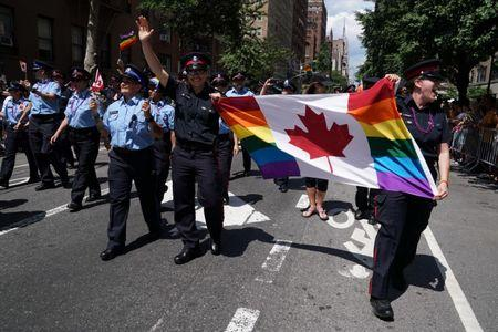 Members of Toronto's Police force take part in the LGBT Pride March in the Manhattan borough of New York City, New York, U.S. June 25, 2017. REUTERS/Carlo Allegri