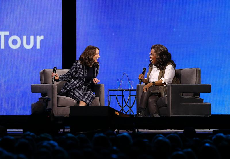 Tina Fey and Oprah lean in and get real. (Credit: Getty Images)