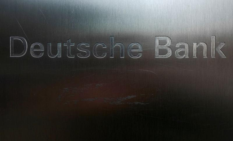 FILE PHOTO - Scratches are seen on the logo of Germany's Deutsche Bank in Frankfurt