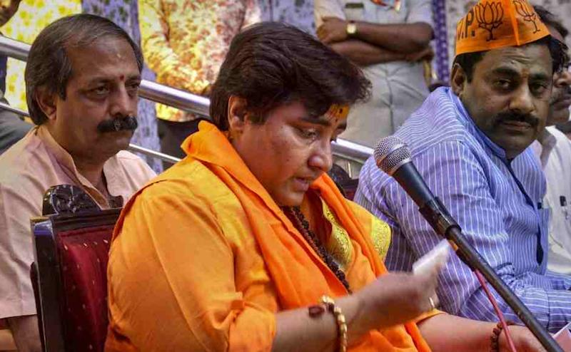 BJP candidate Sadhvi Pragya Singh Thakur reacts while addressing a party workers' meeting for Lok Sabha polls in Bhopal. She courted controversy on Friday by saying that IPS officer Hemant Karkare died in 26/11 Mumbai terror attacks as she had cursed him. PTI