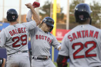 Boston Red Sox's Bobby Dalbec (29) celebrates with Enrique Hernandez, center, after Hernandez hit a two-run home run during the third inning of the team's baseball game against the Toronto Blue Jays on Wednesday, July 21, 2021, in Buffalo, N.Y. (AP Photo/Joshua Bessex)