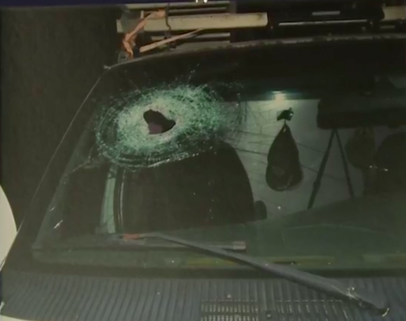 This photo shows a hole left in the windshield of a car thatKenneth Andrew White had been riding in at the time of his fatal injury. (Genesee County Prosecutors Office)