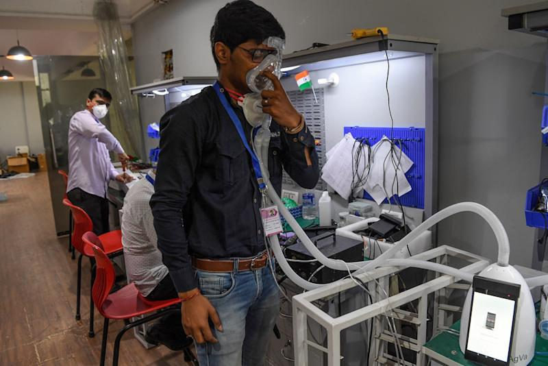 In this photo taken on March 25, 2020, an AgVa Healthcare employee demonstrates using a ventilator at the R&D centre in Noida. (Photo: PRAKASH SINGH via Getty Images)