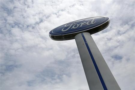 A Ford sign marks the lot at Koons Ford dealership in Fairfax, Virginia