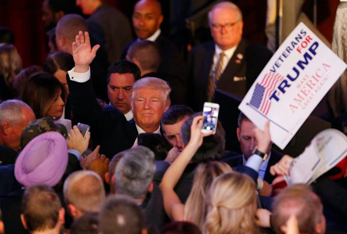 Donald Trump waves to supporters after giving his victory speech after being elected president on November 9, 2016.