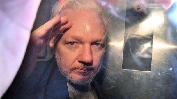 PHOTO: WikiLeaks founder Julian Assange gestures from the window of a prison van as he is driven out of Southwark Crown Court in London on May 1, 2019. (Daniel Leal-olivas/AFP/Getty Images, FILE)