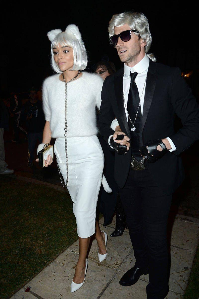 <p>Madekwe arrives at a Halloween party looking catty in winter whites; her boyfriend accompanies her as Chanel designer Karl Lagerfeld. </p>