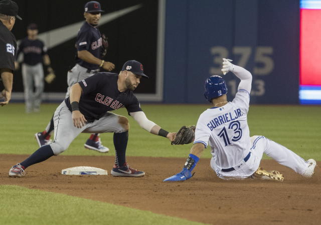 Cleveland Indians' Jason Kipnis, left, gets an easy tag out on Toronto Blue Jays' Lourdes Gurriel Jr. who was trying to steal second base during fourth-inning baseball game action in Toronto, Monday, July 22, 2019. (Fred Thornhill/The Canadian Press via AP)