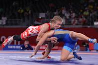 <p>Belarus' Iryna Kurachkina (red) wrestles Russia's Valeria Koblova in their women's freestyle 57kg wrestling quarter final match during the Tokyo 2020 Olympic Games at the Makuhari Messe in Tokyo on August 4, 2021. (Photo by Jack GUEZ / AFP)</p>