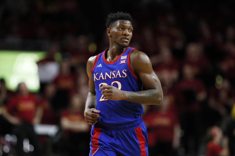 Kansas forward Silvio De Sousa runs up court during the second half of an NCAA college basketball game against Iowa State, Wednesday, Jan. 8, 2020, in Ames, Iowa. Kansas won 79-53. (AP Photo/Charlie Neibergall)