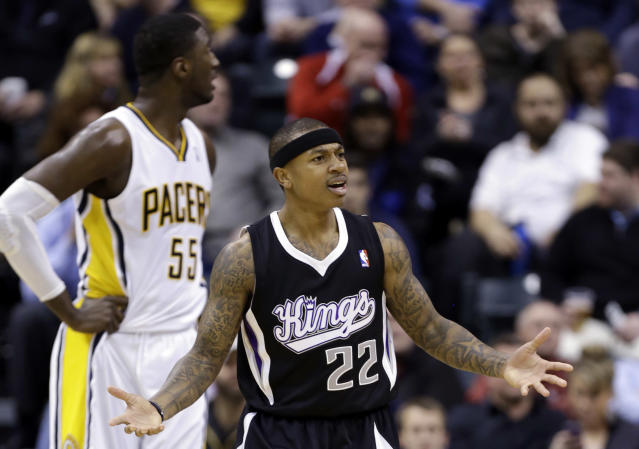 Sacramento Kings guard Isaiah Thomas (22) questions the lack of a call in front of Indiana Pacers center Roy Hibbert in the first half of an NBA basketball game in Indianapolis, Tuesday, Jan. 14, 2014. (AP Photo/Michael Conroy)
