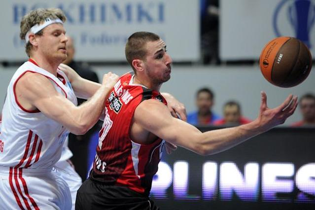 Lietuvos Rytas' Jonas Valanciunas (R) vies with BC Spartak Saint-Petersburg's Miha Zupan during Eurocup's FinalFour third place basketball match between Lietuvos Rytas and BC Spartak Saint-Petersburg in Khimki, a suburb of Moscow, on April 15, 2012. (Photo by Kirill Kudryavtsev /AFP/Getty Images)