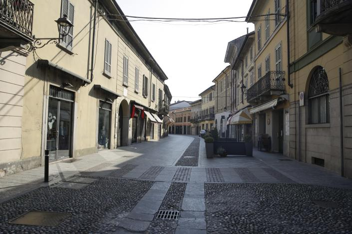 A deserted street in the town of Codogno, near Lodi, Northern Italy, Saturday, Feb. 22, 2020. A dozen northern Italian towns were on effective lockdown Saturday after the new virus linked to China claimed two fatalities in Italy and sickened an increasing number of people who had no direct links to the origin of the virus. The secondary contagions prompted local authorities in towns in Lombardy and Veneto to order schools, businesses and restaurants closed, and to cancel sporting events and Masses. (AP Photo/Luca Bruno)