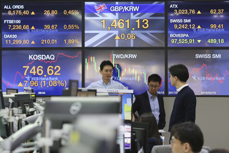 Currency traders work at the foreign exchange dealing room of the KEB Hana Bank headquarters in Seoul, South Korea, Monday, Feb. 18, 2019. Asian markets were broadly higher on Monday as traders looked forward to the continuation of trade talks between Chinese and American officials in Washington this week. (AP Photo/Ahn Young-joon)