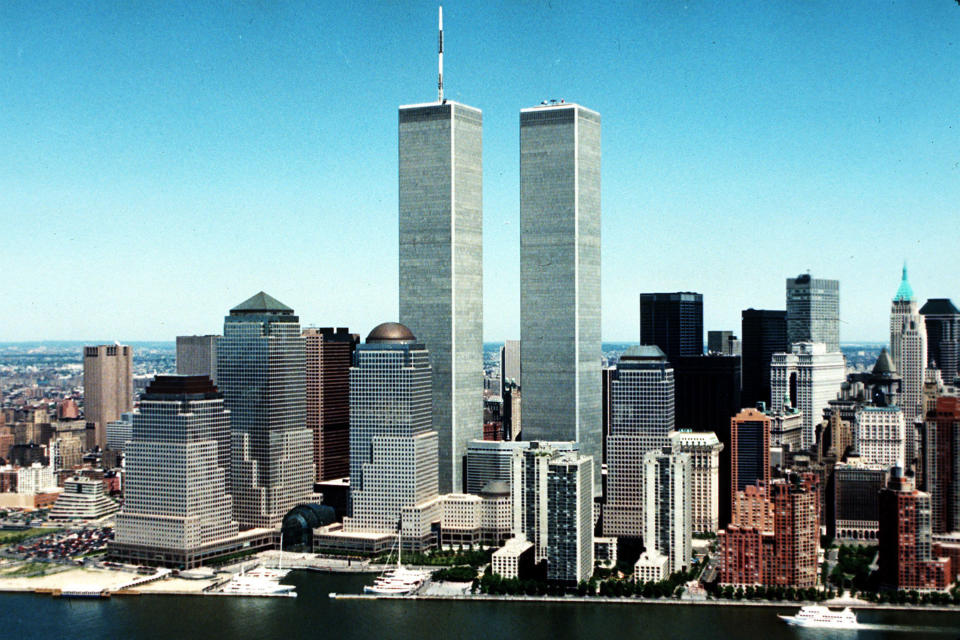 FILE - This 1990 file photo shows the New York City skyline with World Trade Center's twin towers in the center. (AP Photo/File)