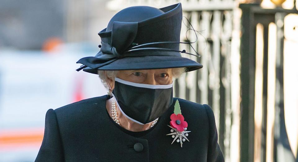 Britain's Queen Elizabeth II arrives for a service to mark the centenary of the burial of the Unknown Warrior ahead of Remembrance Sunday at Westminster Abbey in London on November 4, 2020. - In the small private ceremony, The Queen honoured the Unknown Warrior and the Royal Familys own associations with the First World War and the grave at Westminster Abbey. As part of the ceremony, a bouquet of flowers featuring orchids and myrtle - based on Her Majestys own wedding bouquet from 1947 - was placed on the grave of the Unknown Warrior in an act of remembrance. The gesture reflected the custom of Royal bridal bouquets being placed on the grave. (Photo by Aaron Chown / POOL / AFP) (Photo by AARON CHOWN/POOL/AFP via Getty Images)