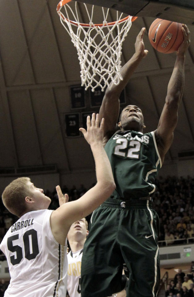 Michigan State guard Branden Dawson, right, shoots over Purdue forward Travis Carroll in the second half of an NCAA college basketball game in West Lafayette, Ind. Sunday, Feb. 19, 2012. Michigan State won 76-62. (AP Photo/AJ Mast)
