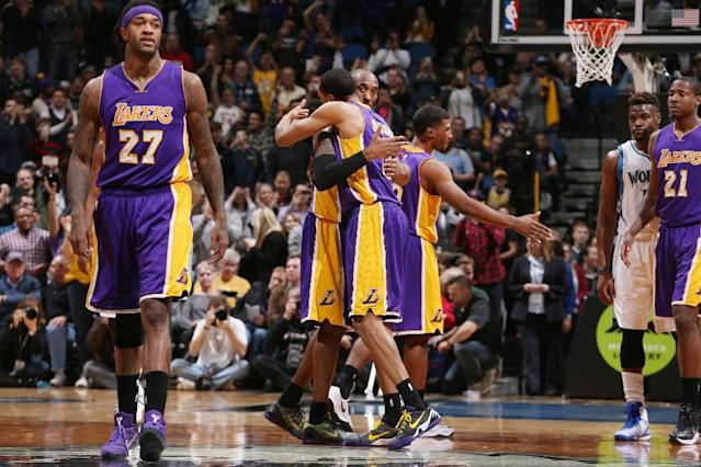 MINNEAPOLIS, MN - DECEMBER 14: Kobe Bryant #24 of the Los Angeles Lakers hugs teammates after he makes the basket that passes Michael Jordan for 3rd All Time on Scoring List during the game on December 14, 2014 at Target Center in Minneapolis, Minnesota. (Photo by David Sherman/NBAE via Getty Images)