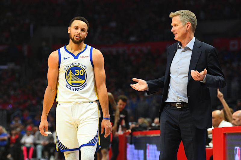 LOS ANGELES, CA - APRIL 21: Golden State Warriors Guard Stephen Curry (30) and head coach Steve Kerr look on during game four of the first round of the 2019 NBA Playoffs between the Golden State Warriors and the Los Angeles Clippers on April 21, 2019 at Staples Center in Las Angeles, CA.(Photo by Brian Rothmuller/Icon Sportswire via Getty Images)