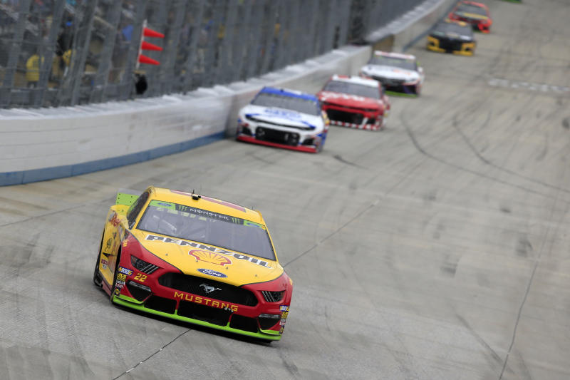 DOVER, DELAWARE - OCTOBER 06: Joey Logano, driver of the #22 Shell Pennzoil Ford, leads a pack of cars during the Monster Energy NASCAR Cup Series Drydene 400 at Dover International Speedway on October 06, 2019 in Dover, Delaware. (Photo by Chris Trotman/Getty Images)