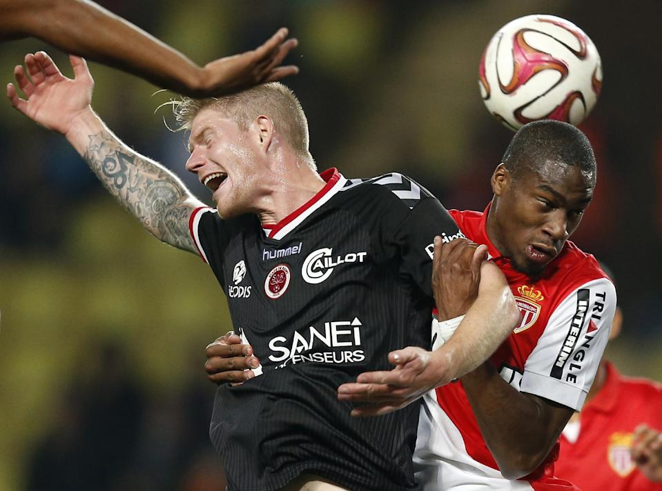 Monaco's Anthony Martial (R) fights for the ball with Reims' Gaetan Charbonnier during their French Ligue 1 match, at the Louis II stadium in Monaco, French Riviera, on October 31, 2014 (AFP Photo/Valery Hache)