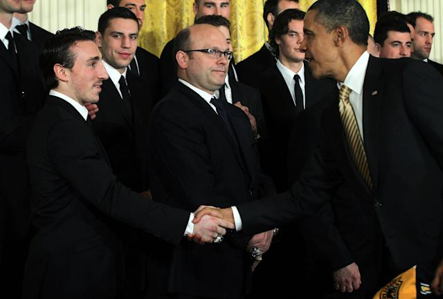WASHINGTON, DC - JANUARY 23: U.S. President Barack Obama (R) shakes hands with hockey player Brad Marchand (L) of the Boston Bruins as team general manager Peter Chiarelli (2nd L) looks on during a East Room event at the White House January 23, 2012 in Washington, DC. The six-time Stanley Cup champions were honored by the President for winning the 2011 Stanley Cup last June. (Photo by Alex Wong/Getty Images)