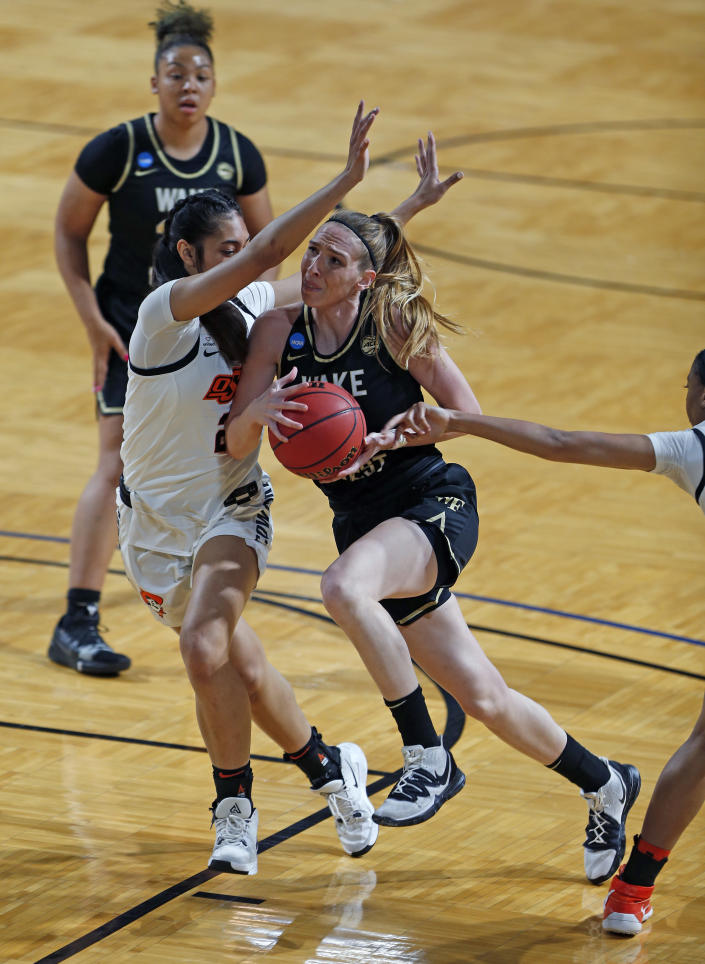 Wake Forest forward Ivana Raca(11) drive past Oklahoma State guard Neferatali Notoa (2) during the first half of a college basketball game in the first round of the women's NCAA tournament at the Greehey Arena in San Antonio, Texas, Sunday, March 21, 2021. (AP Photo/Ronald Cortes)