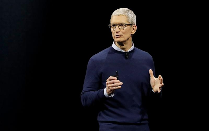 Apple boss Tim Cook on stage during the Worldwide developer's conference in June 2017 - AP