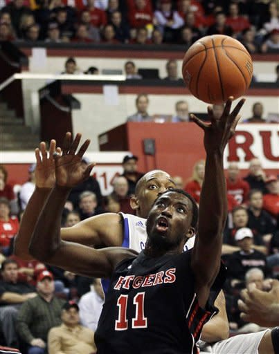 Rutgers' Dane Miller (11) shoots in front of Seton Hall's Brandon Mobley during the first half of an NCAA college basketball game in Piscataway, N.J., Wednesday, Feb. 8, 2012. (AP Photo/Mel Evans)