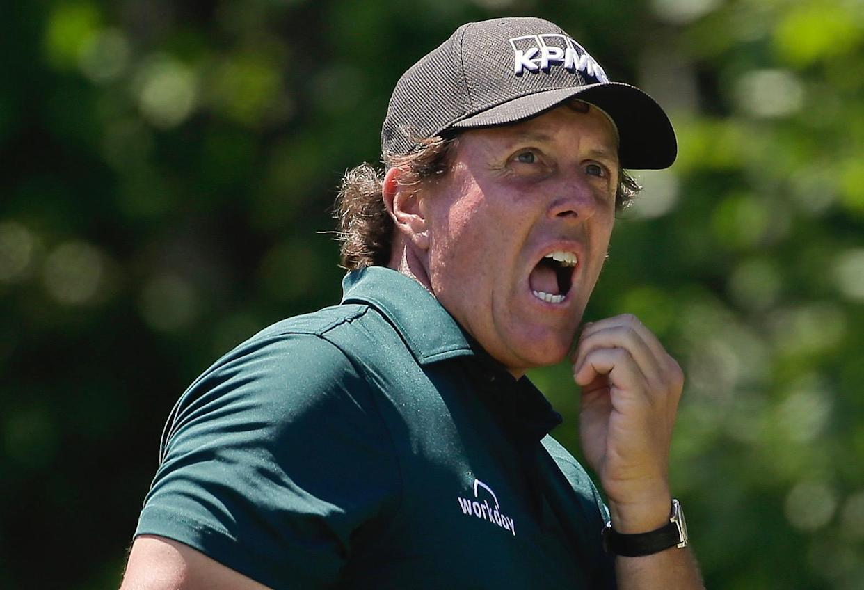 "Phil Mickelson reflected on his ""rough month"" Thursday ahead of next week's Open Championship, vowing to ""act a little better"" after a pair of rules violations. (AP)"