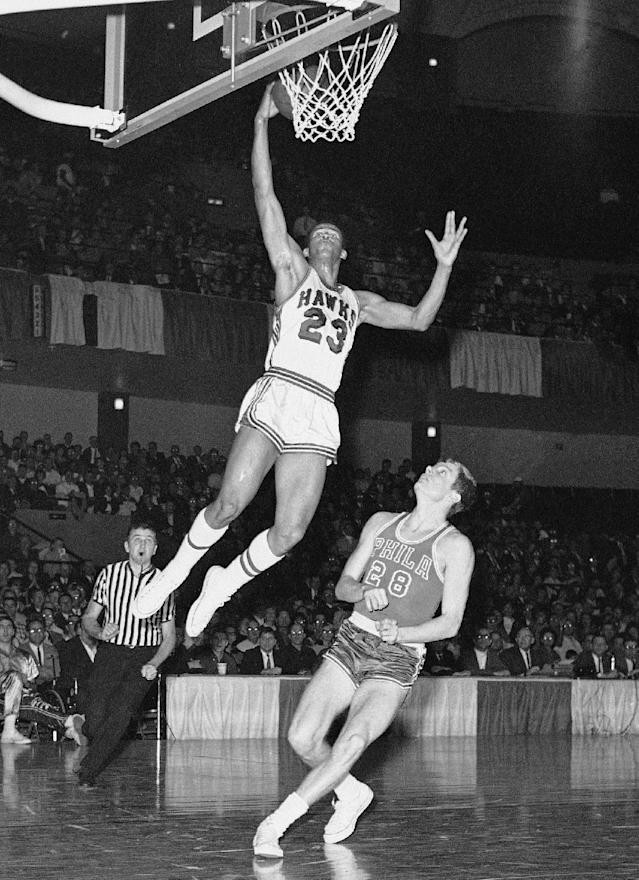 FILE - In this Jan. 31, 1967 file photo, St. Louis Hawks rookie forward Lou Hudson (23) goes to the basket against Philadelphia's Bill Melchionni, in St. Louis. Six-time All-Star Lou Hudson died Friday, April 11, 2014, in Atlanta, the Atlanta Hawks said. He was 69. (AP Photo/File)