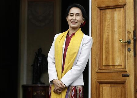 Myanmar's opposition leader Suu Kyi smiles after her meeting with former Polish president Walesa in Warsaw